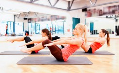 31098085 - fitness, sport, training, gym and lifestyle concept - group of smiling women exercising on mats in the gym